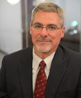 John E. Hannum, Partner